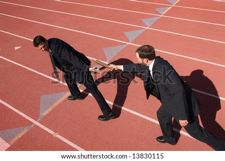 stock photo : Businessmen passing the baton in a track relay