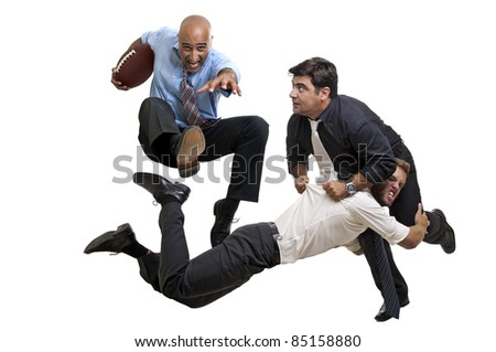 Businessmen playing rugby isolated in white