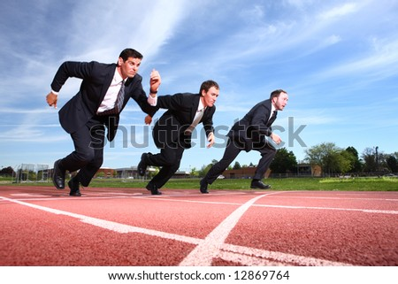 Businessmen running on track - stock photo