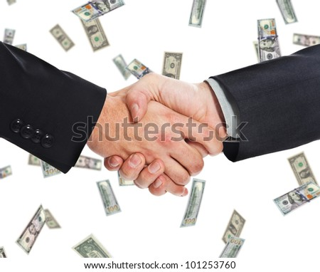 Businessmen shaking hands against a rain of money