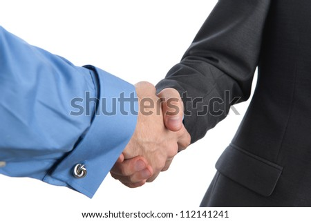 businessmen shaking hands closeup, isolated on white
