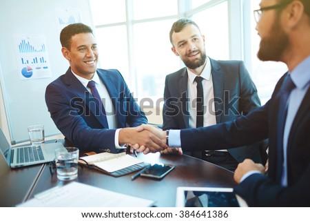 businessmen shaking hands...
