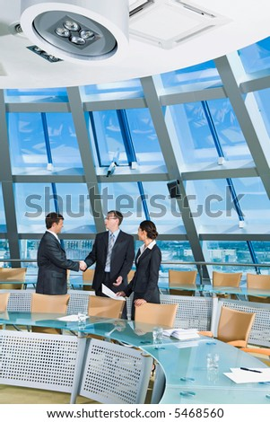 Businessmen shaking hands in the conference room