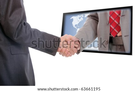 Businessmen shaking hands out of TV screen