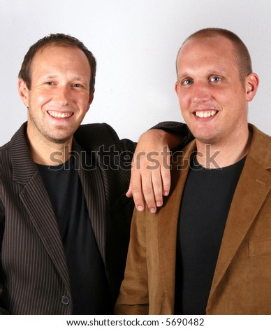 Businessmen Smiling Two you businessmen stand like partners. Isolated studio shot!