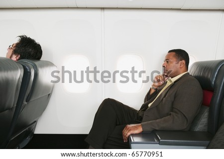 Businessmen traveling in an airplane