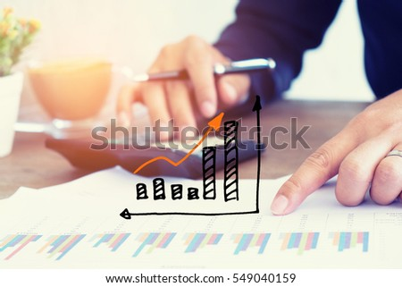 Businessmen use the calculator to calculate and analyze the comp #549040159