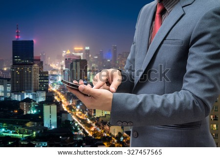 businessmen using smart phone with blur city night background  #327457565