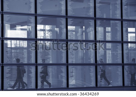 Businessmen walking in a hallway