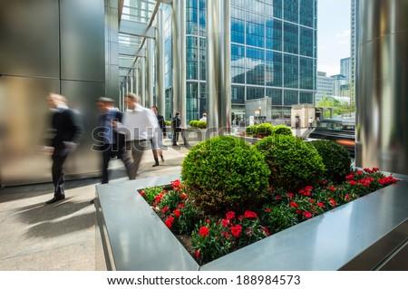 Businessmen walking outside of modern office buildings