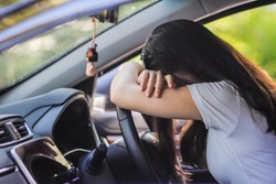 Businessmen who are driving a car along the road have a headache because of the accumulated stress from doing unsuccessful business and have to take the effort to revive the business by themselves.