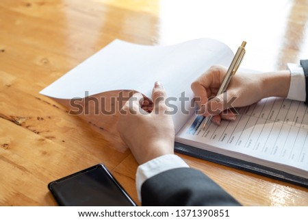 Businessmen who are filling out applicant information in the company application form.