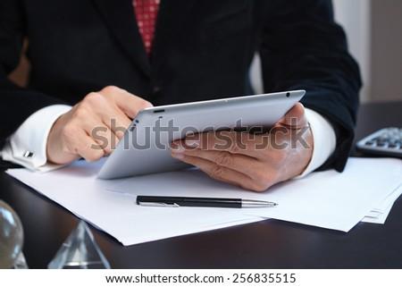 businessmen with digital tablet