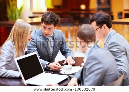 Businessmen with laptop in a meeting at the office