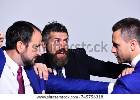 Businessmen with strict and scared faces in formal wear on grey background. Coworkers decide upon best working position. Business conflict and argument concept. Leaders fight for business leadership #745756318