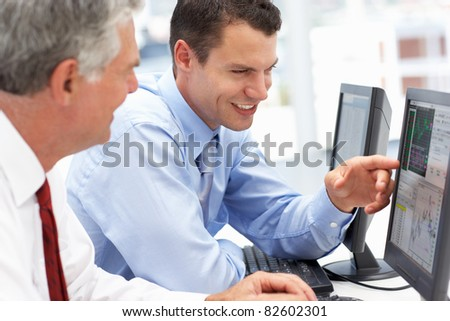 Businessmen working on computers