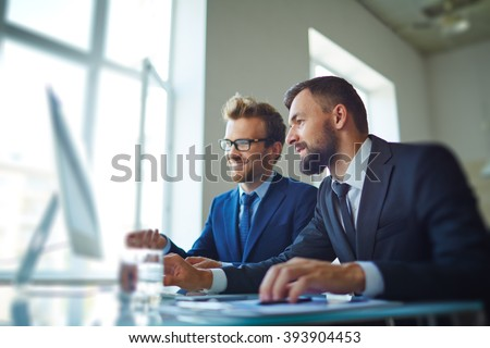 Businessmen working with computer in team #393904453