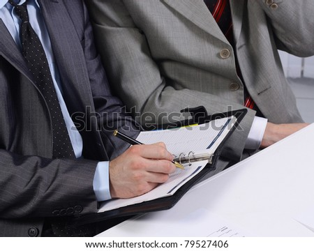 Businessmen working with documents in the office