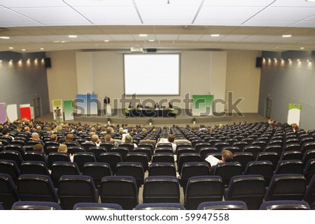 Businessmen works at a conference in big conference hall