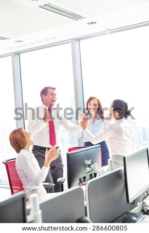 Businesspeople celebrating success in office #286600805
