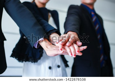 Businesspeople cooperate work together partnership teamwork. Business teamwork successful concept