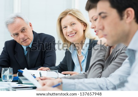 Businesspeople Discussing In Conference Room