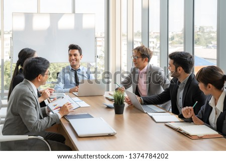 Businesspeople discussing together in conference room during meeting at office #1374784202