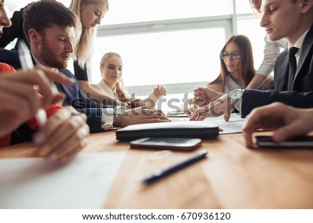 Businesspeople discussing together in conference room during meeting at office #670936120