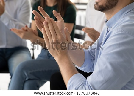 Businesspeople employees clapping hands express gratitude to trainer for presentation accomplish seminar close up view. Rehab group session encourage newcomer after telling personal life story concept