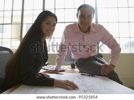 Businesspeople examining blueprints
