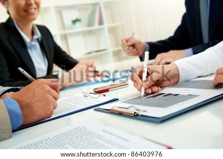 Businesspeople examining documents at their workplace