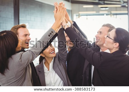Businesspeople hands stacked over each other in office #388583173