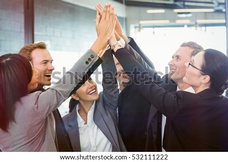 Businesspeople hands stacked over each other in office #532111222