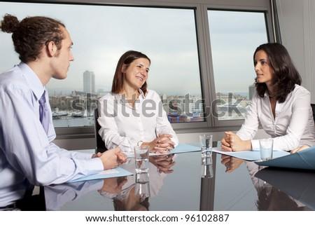 Businesspeople having a break during meeting