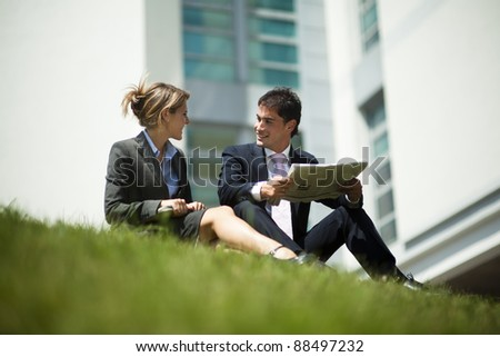 Businesspeople Having Break Outdoors