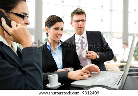 Businesspeople having discussion over the coffee table.