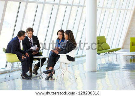 businesspeople having meeting...