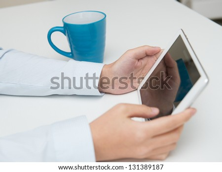 Businesspeople holding digital tablet, closeup.