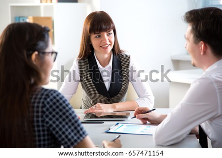 Businesspeople in a meeting at office - Shutterstock ID 657471154