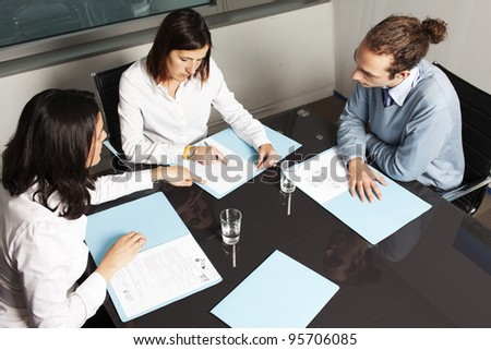 businesspeople interacting at business meeting