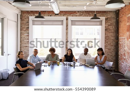 Businesspeople Listening To Presentation In Boardroom #554390089