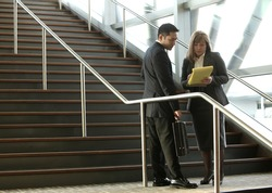 Businesspeople meeting on steps