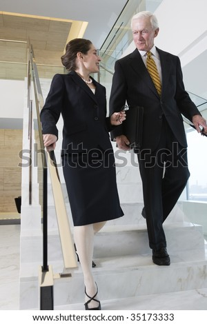 Businesspeople on stairway.