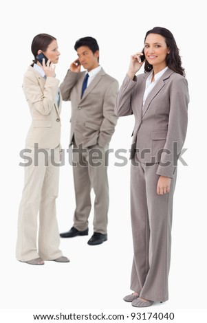 Businesspeople on their phones against a white background