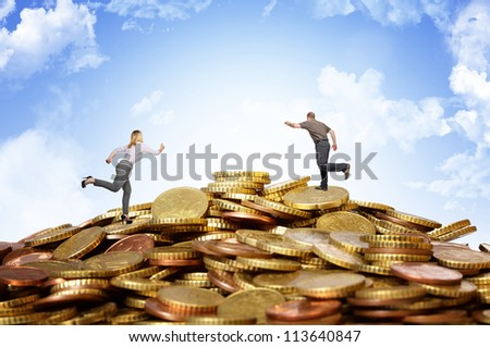 businesspeople running on money coins hill
