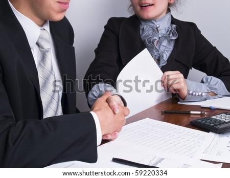 businesspeople shaking hands after agreement