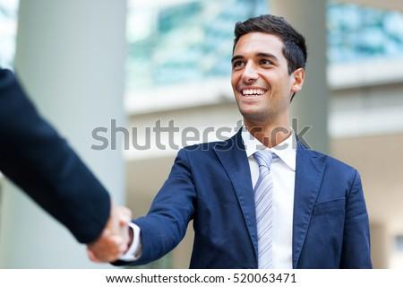 Businesspeople shaking hands outdoor
