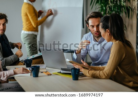 Businesspeople sitting at the desk in the office and working together Stockfoto ©