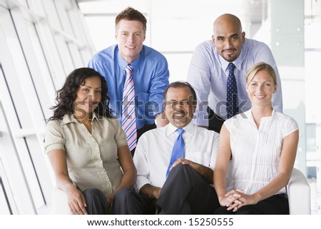 Businesspeople sitting in office lobby