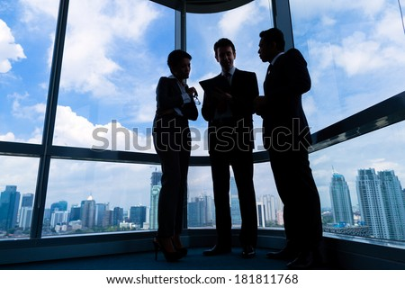Businesspeople standing in modern office